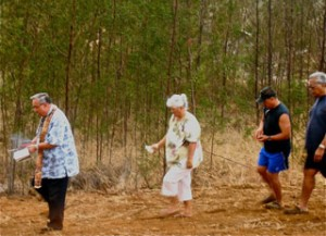 Kahu Silva blesses the land before a home is constructed.