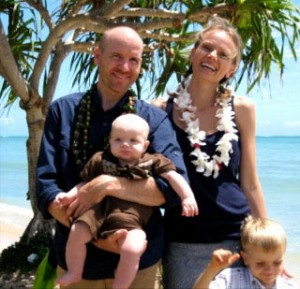 Family celebrating baby birthday at Kualoa Beach