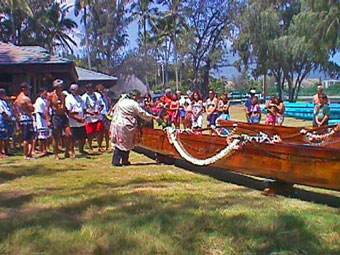 Kahu Silva performs blessings for all of the canoes of the Kailua canoe club